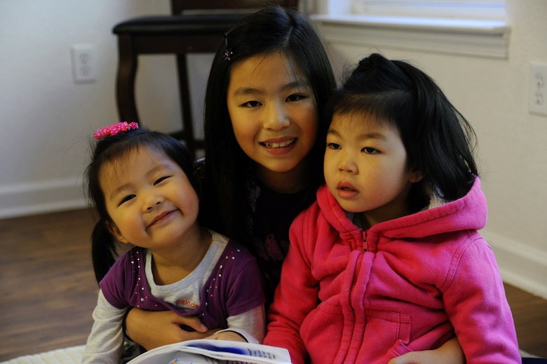 From left, Mary, Grace and Sophia Hong, daughters of U.S. Army Sgt. David Hong, Fort Eustis chaplain assistant, pose in their home at Fort Eustis, Va., Oct. 21, 2013. Sophia has Dravet syndrome, a rare form of intractable epilepsy that begins in infancy, and due to her condition, Grace and Mary always keep a close eye on their sister. (U.S. Air Force photo by Airman 1st Class Austin Harvill/Released)