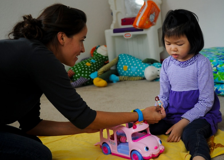 Alona Luckey, an Applied Behavioral Analysis tutor, plays with Sophia, 5-year-old daughter of U.S. Army Sgt. David Hong, Fort Eustis chaplain assistant, at Fort Eustis, Va., Oct. 7, 2013. Sophia has Dravet syndrome, a rare form of intractable epilepsy that begins during infancy, and has to sleep in a room full of mattresses as most of her seizures happen at night. (U.S. Air Force photo by Airman 1st Class Austin Harvill/Released)