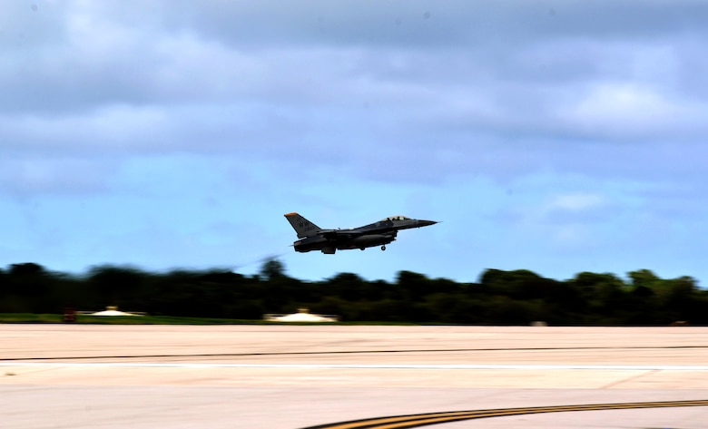 A 14th Fighter Squadron F-16 Fighting Falcon pilot from Misawa Air Base, Japan, takes off from Andersen Air Force Base, Guam, during a training mission  Oct. 29, 2013 The Airmen are from the 35th Fighter Wing at Misawa AB, and are here to gaining an opportunity to train in a less restricted air space.(U.S. Air Force photo by Airman 1st Class Mariah Haddenham/Released)