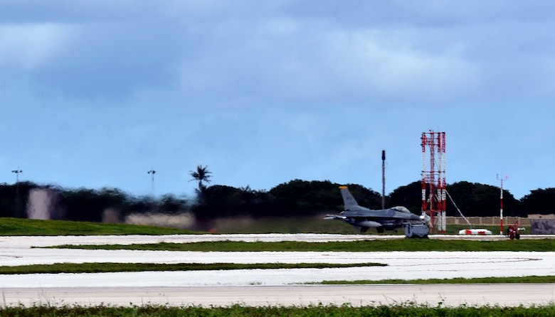 A 14th Fighter Squadron F-16 Fighting Falcon pilot from Misawa Air Base, Japan, begins takeoff as a part of a training mission on Andersen Air Force Base, Guam, Oct. 29, 2013. Andersen has operated as a host base for the Aviation Training Relocation program since 2011, when it was selected by a joint Japan-U.S. committee due to the limited flying regulations and close proximity to local populations in Japan.(U.S. Air Force photo by Airman 1st Class Mariah Haddenham/Released)