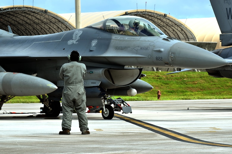 A 14th Fighter Squadron pilot from Misawa Air Base, Japan, prepares for a training mission on Andersen Air Force Base, Guam, Oct. 29, 2013. Andersen has operated as a host base for the Aviation Training Relocation program since 2011, when it was selected by a joint Japan-U.S. committee due to the limited flying regulations and close proximity to local populations in Japan.(U.S. Air Force photo by Airman 1st Class Mariah Haddenham/Released)