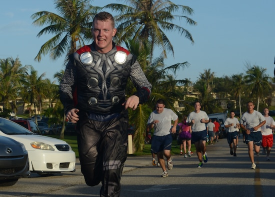A Halloween Hustle 5K Fun Run and Walk participant dressed as the character Thor finishes the race Oct. 30, 2013, on Andersen Air Force Base, Guam. Approximately 350 people participated in the Halloween Hustle as part of the monthly 5K event conducted by Coral Reef Fitness Center Airmen. (U.S. Air Force Photo by Airman 1st Class Emily A. Bradley/Released)