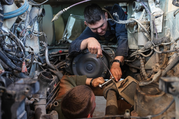 Corporal Jose L. Polanco (top), a 25-year-old heavy equipment mechanic for Combat Logistics Battalion 31, 31st Marine Expeditionary, and a native of Truth or Consequences, N.M., loosens a drive shaft mount with the assistance of Lance Cpl. Tanner M. Jones, a 19-year-old light armored vehicle mechanic for CLB-31, 31st MEU, and a native of Denver, Colo., here, Sept. 1. The Marines of CLB-31's maintenance section are working long days and late nights to keep pace with the required maintenance that comes with supporting the battalion-sized element currently executing Exercise Koolendong 13. Koolendong is a week-long, live-fire exercise that demonstrates the operational reach of the 31st MEU. Also participating in the exercise is the Marine Rotational Force – Darwin and soldiers of the 5th Royal Australian Regiment. The 31st MEU brings what it needs to sustain itself to accomplish the mission or to pave the way for follow-on forces. The 31st MEU is the Marine Corps' force in readiness for the Asia-Pacific region and the only continuously forward-deployed MEU.