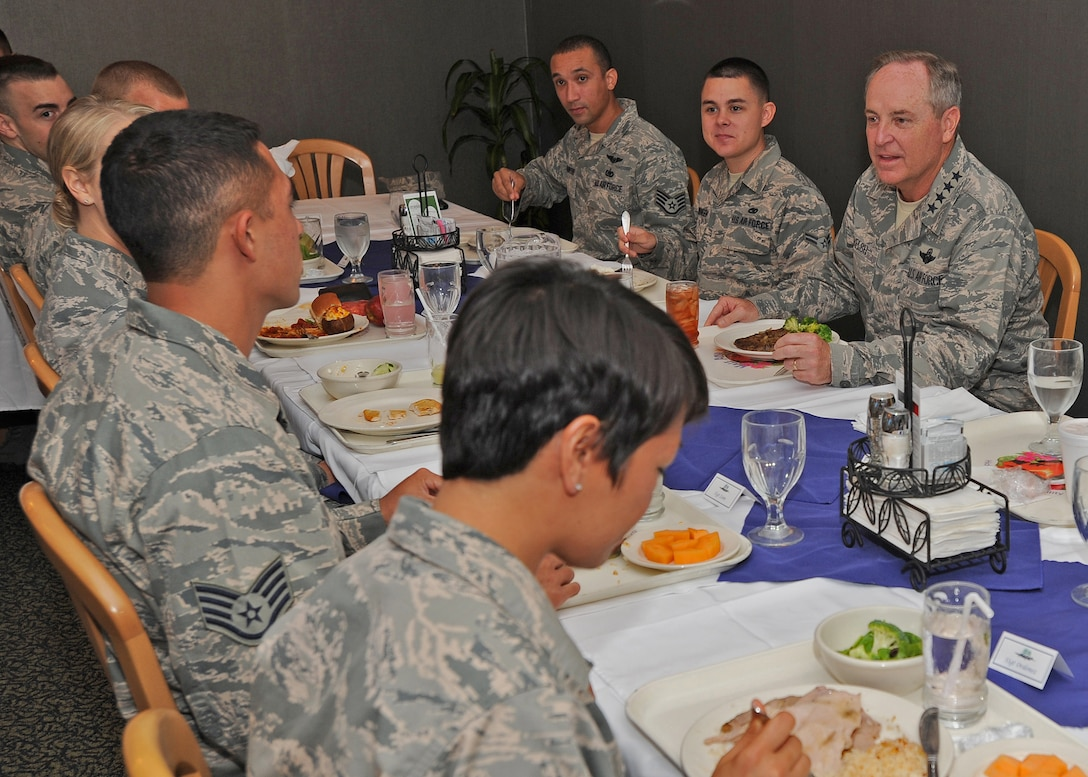 Air Force Chief of Staff Gen. Mark A. Welsh III shares lunch with Pacific Air Forces Airmen at the Hale Aina Dining Facility at Joint Base Pearl Harbor-Hickam, Hawaii, Aug. 19, 2013. As part of a three-day visit to Hawaii, Welsh thanked Airmen for their continued service and dedication and addressed issues concerning Airmen and their families. (U.S. Air Force photo/Tech. Sgt. Jerome S. Tayborn)