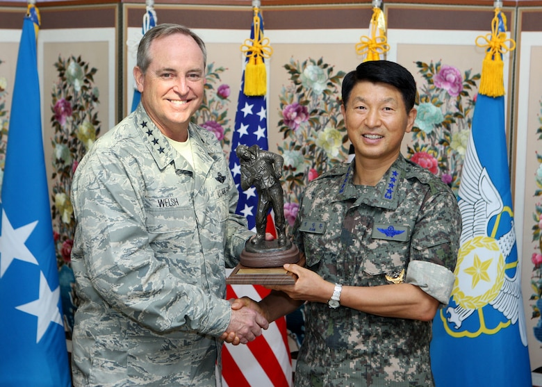 Air Force Chief of Staff Gen. Mark A. Welsh III and Republic of Korea Air Force Chief of Staff Gen. Sung Il-Hwan exchange gifts following a meeting in Seoul, Republic of Korea, Aug. 23, 2013. As part of a two-week tour of the Pacific, Welsh met with military partners in Korea and Japan, as well as Airmen and their families, to discuss opportunities and challenges in the region. (Courtesy photo/Republic of Korea Air Force)