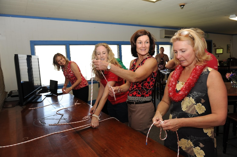 Athena Cody, right, wife of Chief Master Sgt. of the Air Force James A. Cody, and Betty Welsh, wife of Air Force Chief of Staff Gen. Mark A. Welsh III, Marlo Nikkila, Wet Hens treasurer, and Gillian Carlisle, wife of Gen. Hawk Carlisle, commander of Pacific Air Forces, practice tying knots with the spouse's sailing club, 'Wet Hens', at the Outdoor Recreation Center on Joint Base Pearl Harbor-Hickam, Hawaii, Aug. 19, 2013. The visit to Hawaii is part of Gen. Welsh and Chief Cody's first visit to the Pacific theater and includes stops in Alaska, Japan and the Republic of Korea. Mrs. Welsh and Mrs. Cody met with family members and spouses to discuss opportunities and challenges regarding family care in the Pacific region. (U.S. Air Force photo/Master Sgt. Matthew McGovern)