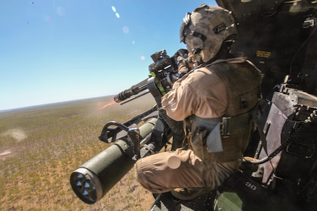 Sergeant Brian D. Richardson, a 29-year-old crew chief for Marine Medium Tiltrotor Squadron 265 (Reinforced), 31st Marine Expeditionary Unit, and a native of Leesburg, Fla., fires a 7.62mm GAU-17/A weapon system at enemy targets from a UH-1Y Venom helicopter during live-fire training as part of Exercise Koolendong 13 here, Sept. 2. Three Venom helicopters and four MV-22 Osprey aircraft are operating from an expeditionary airfield 300 miles inland from the Port of Darwin, supporting the battalion-sized element conducting the exercise. Koolendong demonstrates the operational reach of the 31st MEU. Also participating in the exercise is the Marine Rotational Force – Darwin and soldiers of the 5th Royal Australian Regiment. The 31st MEU brings what it needs to sustain itself to accomplish the mission or to pave the way for follow-on forces. The 31st MEU is the Marine Corps' force in readiness for the Asia-Pacific region and the only continuously forward-deployed MEU.