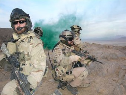 Senior Airman Brandon Daugherty, then-Master Sgt. Jeremy Hardy and Staff Sgt. Jason Blettenburg keep close watch during a combat rescue for an injured Afghan National Police soldier in Kandahar Province, Afghanistan Nov. 2007. (U.S. Air Force/Courtesy photo)