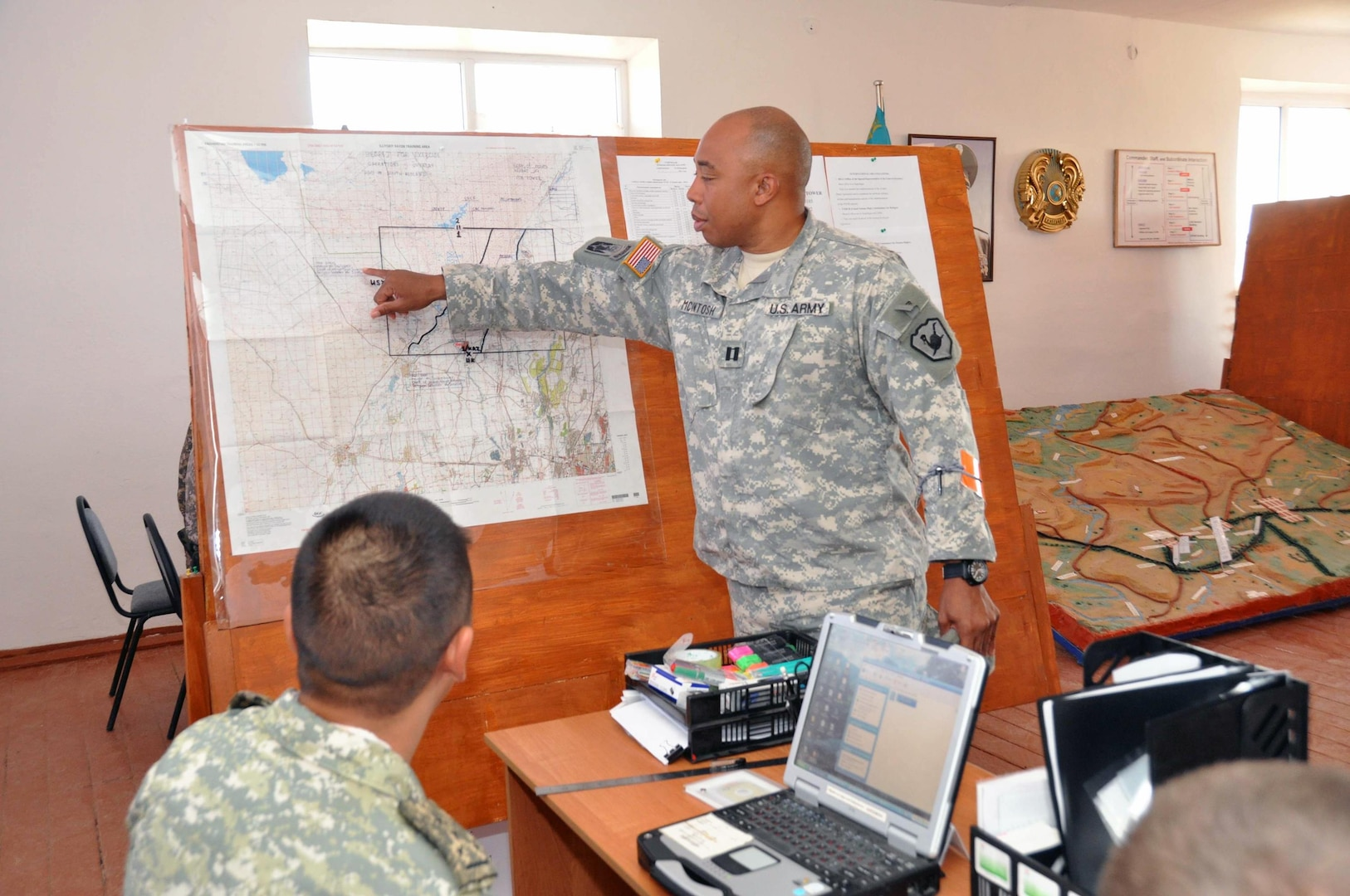 Army Capt. Terrannce McIntosh, standing, shows his Kazakh counterpart troop positions during Exercise Steppe Eagle 12, conducted in Kazakhstan in September 2012. Arizona and Kazakhstan have been partnered under the National Guard's State Partnership Program for 20 years.