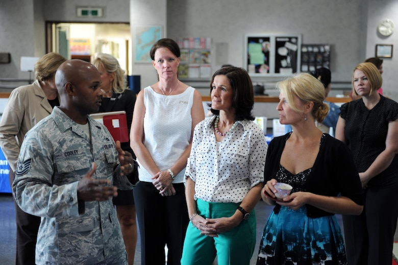 Tech. Sgt. Jonathan Cooley speaks with Betty Welsh, center, wife of  Chief of Staff of the Air Force Gen. Mark A. Welsh III, Athena Cody, right, wife of Chief Master Sergeant of the Air Force James A. Cody, and 374th Airlift Wing spouses Aug. 27, 2013, at Yokota Air Base, Japan. Welsh and Cody learned about programs and operations at Yokota while they took part in a tour of the base. Cooley is with the 374th Force Support Squadron. (U.S. Air Force photo/Senior Airman Desiree Economides)