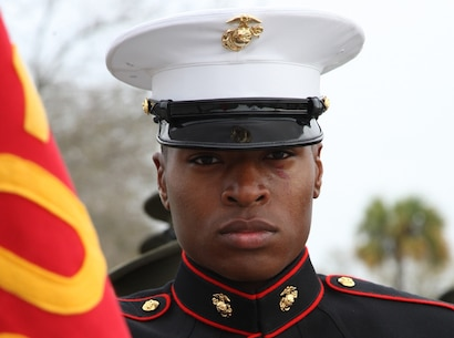 U.S. Marine Corps Pfc. Christopher Otoki, honor graduate, Platoon 3016, Mike Company, 3rd Recruit Training Battalion, stands at parade rest before marching onto the Peatross Parade Deck for the graduation ceremony of Mike and November Companies on Marine Corps Recruit Depot Parris Island, S.C., March 9, 2012. Otoki earned the platoon honor graduate distinction with the highest combined score in physical fitness, rifle qualification and educational scores as well as demonstrating leadership.