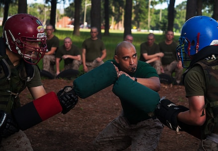 Sgt. Roberto Martinez, 33, a martial arts instructor on Parris Island, initiates a pugil stick match during training July 8, 2013, on Parris Island, S.C. Each recruit participated in two 15-second matches. Recruits train with pugil sticks, which represent rifles with attached bayonets, to simulate close-range encounter with an enemy. Bayonet training, along with other hand-to-hand fighting skills, is encompassed in the Marine Corps Martial Arts Program, which contributes to the mental, character and physical development of Marines. Approximately 20,000 recruits come to Parris Island annually for the chance to become United States Marines by enduring 13 weeks of rigorous, transformative training. Parris Island is home to entry-level enlisted training for 50 percent of males and 100 percent of for females in the Marine Corps. Martinez is from West Covina, Calif. Hotel Company is scheduled to graduate Sept. 20, 2013. (Photo by Lance Cpl. David Bessey)