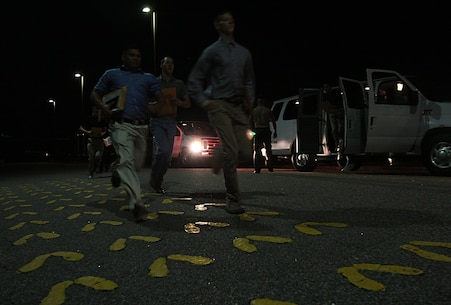 New recruits rush off a bus and onto the yellow footprints on Parris Island, S.C. Recruits learn from the moment they step on the footprints they are expected to move with speed and intensity and to respond to all commands loudly and confidently. The first day is one of many they will spend learning what it takes to earn the title of United States Marine.