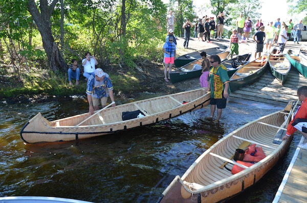 MCGREGOR, Minn. -- Members of the St. Croix Ojibwe Tribe launch their hand-made birchbark canoes at Big Sandy Lake, near McGregor, Minn., July 31. About 200 people gathered to remember the more than 400 Anishinaabe people that died during the winter of 1850-1851.