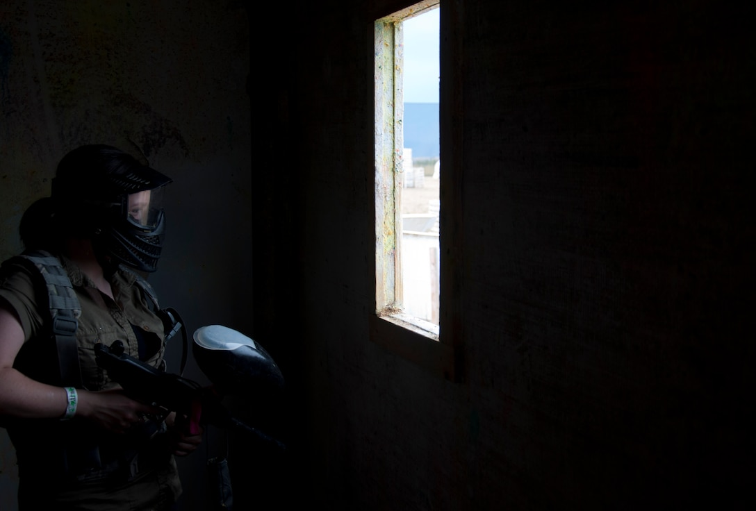 "130831-F-GZ967-079 Airman Siobhan Lynch, 90th Medical Group family health front desk clerk, stands in a dark room as she prepares to defend the building from the attacking ""zombies."" Lynch was part of a group of Airman who spent the day paintballing in Northern Colorado. (U.S. Air Force photo by Airman 1st Class Brandon Valle)"