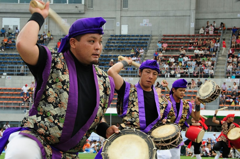 A Taiko drum group performs for the crowd during the 58th Okinawa Zento Eisa Festival in Koza Athletic Park Aug. 31, 2013. This island-wide event is the largest of its kind in Okinawa and lasts for three days. (U.S. Air Force photo by Staff Sgt. Darnell T. Cannady)