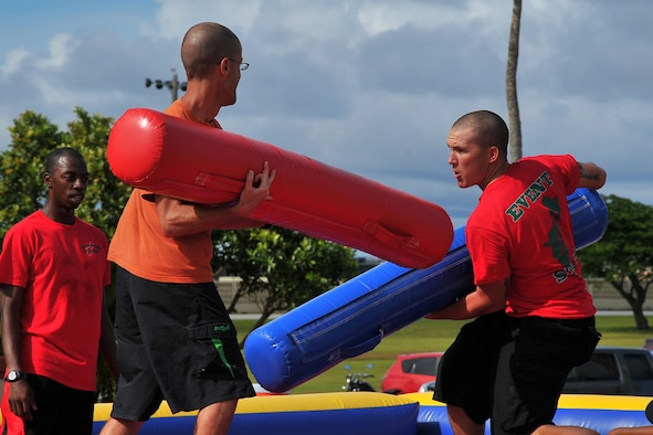 Master Sgt. Garrett Toomas, 36th Wing Command Post, and Army Spc. Matthew Harris, 94th Army Air and Missile Defense Command, participate in the Last Man Standing contest during the Labor Day Bash Aug. 30, 2013, on Andersen Air Force Base, Guam. More than 200 military members and their families attended the event which was held at the Arc Light Memorial Park. (U.S. Air Force photo/Staff Sgt. Melissa B. White/Released)