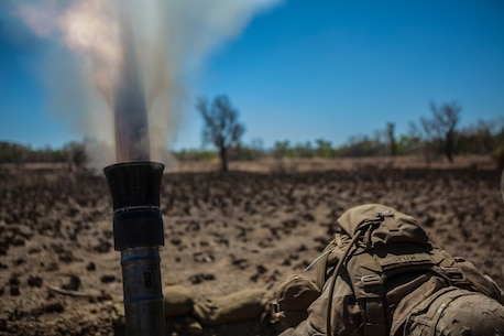 A Marine with Battalion Landing Team 2nd Battalion, 4th Marines, 31st Marine Expeditionary Unit, takes cover as an 81mm mortar fires during a combined, live-fire exercise for Exercise Koolendong 13 here, Sept. 3. The 31st MEU moved a battalion-sized force more than 300 miles inland from the Port of Darwin to conduct training. The exercise demonstrates the operational reach of the 31st MEU. Also participating in the exercise is the Marine Rotational Force – Darwin and soldiers of the 5th Royal Australian Regiment. The 31st MEU brings what it needs to sustain itself to accomplish the mission or to pave the way for follow-on forces. The 31st MEU is the Marine Corps' force in readiness for the Asia-Pacific region and the only continuously forward-deployed MEU.