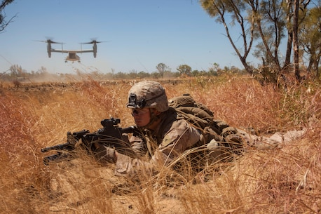 Lance Cpl. John Ready, an M27 Infantry Automatic Rifle gunner for Company E., Battalion Landing Team 2nd Battalion, 4th Marines, 31st Marine Expeditionary Unit, provides security as an MV-22 Osprey from Marine Medium Tiltrotor Squadron 265 (Reinforced), 31st MEU, takes off after inserting a platoon of Marines during a combined, live-fire exercise for Exercise Koolendong 13 here, Sept. 3. The 31st MEU moved a battalion-sized force more than 300 miles inland from the Port of Darwin to conduct training. The exercise demonstrates the operational reach of the 31st MEU. Also participating in the exercise is the Marine Rotational Force – Darwin and soldiers of the 5th Royal Australian Regiment. The 31st MEU brings what it needs to sustain itself to accomplish the mission or to pave the way for follow-on forces. The 31st MEU is the Marine Corps' force in readiness for the Asia-Pacific region and the only continuously forward-deployed MEU.