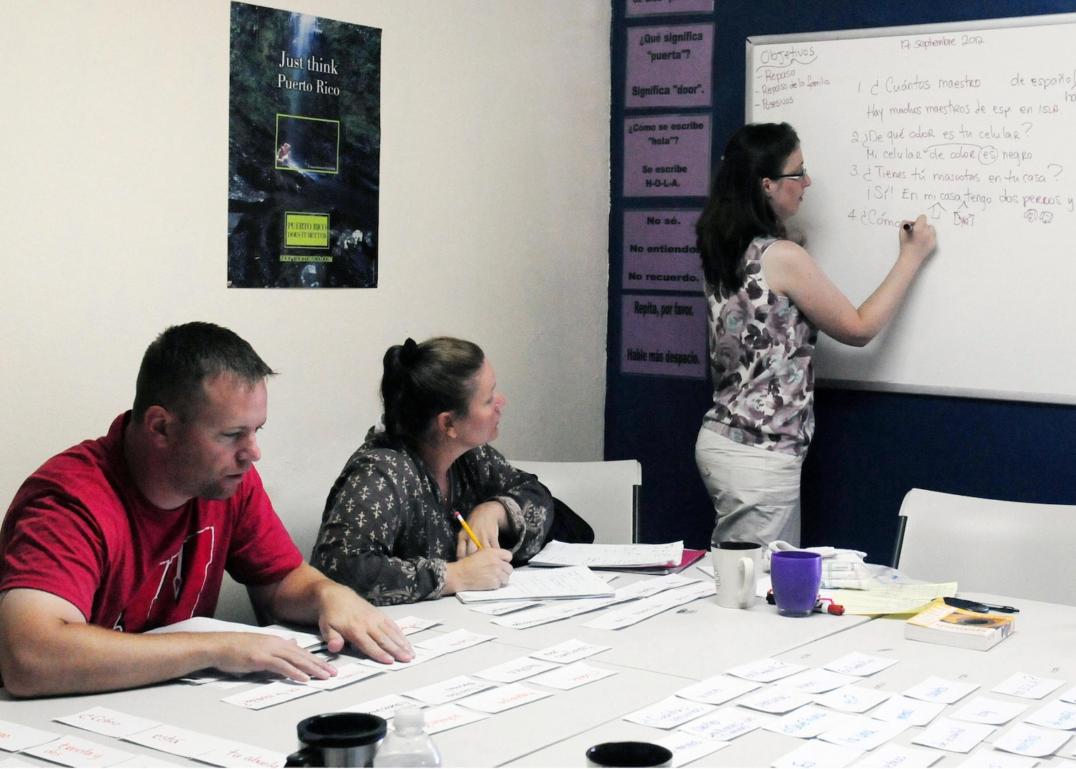 Anna Holt, Spanish instructor at the Institute for Second Language Acquisition, Inc., teaches sentence structure as Military Engagement Team members learn and take notes, Sept. 17. The Military Engagement Team, consisting of 10 Wisconsin National Guard Soldiers spent two weeks in San Juan, Puerto Rico learning the language and about Spanish culture.
