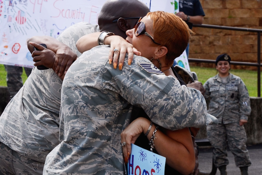 Members of the 94th Security Forces Squadron were received with open arms by family, friends, and fellow reservists as they arrive back on Dobbins Air Reserve Base, Ga., from   deployment to the Middle East Sep. 3. (U.S. Air Force photo/Don Peek)