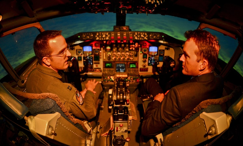 The Acting Secretary of the Air Force Eric Fanning receives lessons from Capt. Steven Whitson, a pilot instructor, in a flight simulator Aug. 29, 2013, at MacDill Air Force Base, Fla.,. The use of simulators are becoming more and more important due to increasing budget constraints. (U.S. Air Force photo/Ned T. Johnston)