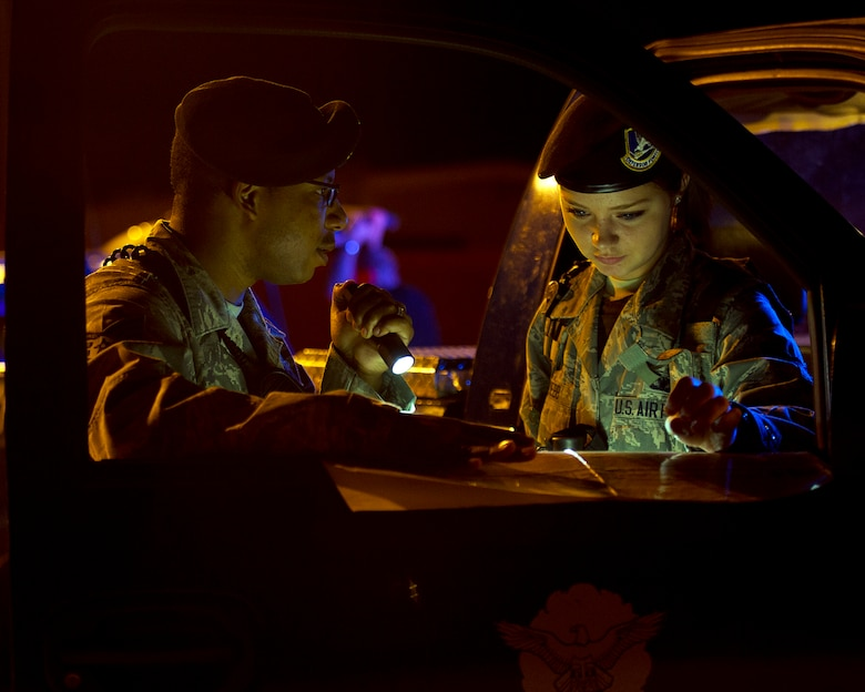 Staff Sgt. Matthew Boyd (left) and Airman 1st Class Sheridyn Webb review an airfield map during a simulated security incident on the flightline Aug. 28, 2013, at Altus Air Force Base, Okla. Boyd is a flight sergeant assigned to the 97th Security Forces Squadron and Webb is a 97th SFS response force member. (U.S. Air Force photo/Senior Airman Kenneth W. Norman)