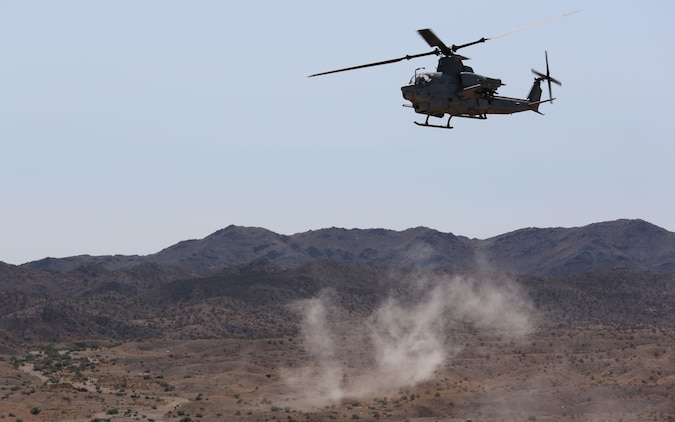 An AH-1Z super cobra helicopter circles around to a target for immediate fire drills at a range northwest of Marine Corps Air Station Yuma, Ariz., Aug. 15., in support of a team of joint terminal attack controllers with 3RD Air Naval Gunfire Liaison Company Marine Forces Reserve, based out of the Armed Forces Reserve Center in Bell, Calif. (Photo by Cpl. Uriel Avendano