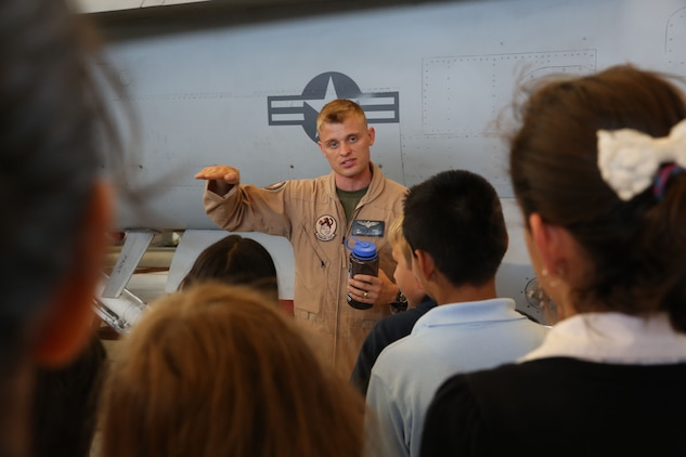 Capt. John Kress, Marine All-Weather Fighter Attack Squadron 224 pilot, speaks about the various capabilities of the F/A-18 Hornet during a Starbase visit, Aug. 28.