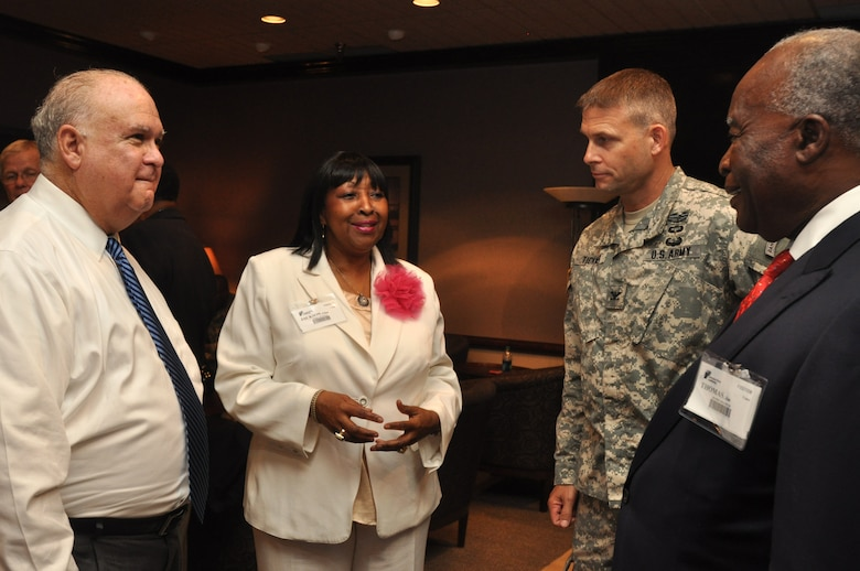 SAVANNAH, Ga. –Under Secretary of the Army Dr. Joseph W. Westphal, joined by Col. Thomas Tickner, commander of the U.S. Army Corps of Engineers Savannah District, speak with the mayors of Savannah and Hinesville, Edna Jackson and Jim Thomas, during a visit to the Georgia Ports Authority, Sept. 4, 2013.