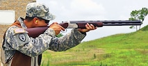 Spc. Thong Bouphavong, EOD specialist, 630th EOD Co., takes aim during a trap-shooting event as part of the 84th EOD Bn. NCO and Soldier of the Quarter competition Aug. 15 at Fort Riley.  Photo by: Sgt. Dana Moen, 1ST SUST. BDE.