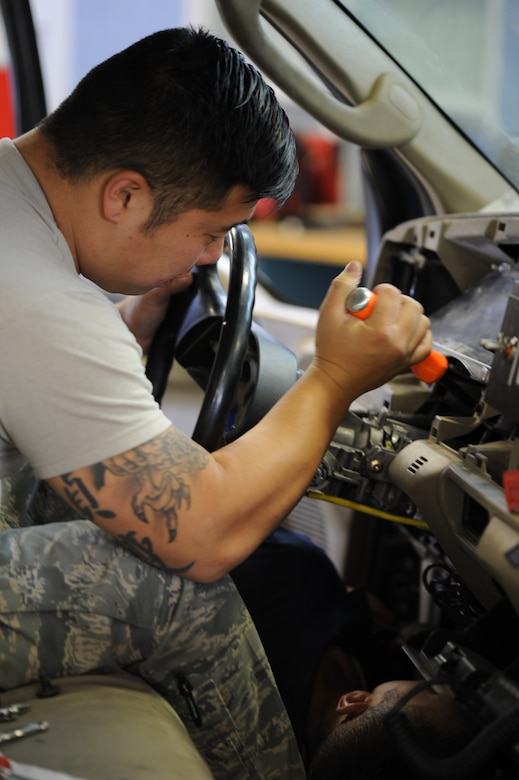 U.S. Air Force Senior Airman Hyung Kil, 366th Logistics Readiness Squadron vehicle and vehicular maintenance journeyman, uses a screwdriver to remove a steering column Aug. 26, 2013, at Mountain Home Air Force Base, Idaho. Vehicle maintenance Airmen are responsible for maintaining an extremely diverse fleet and must be able to meet deadlines regardless of the amount or type of work required. (U.S. Air Force photo by Senior Airman Benjamin Sutton/Released)