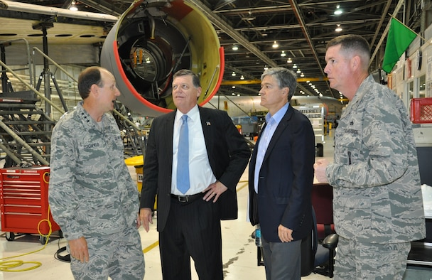 Lt. Gen. Bruce Litchfield, Air Force Sustainment Center commander, left, and Brig. Gen. Donald Kirkland, Oklahoma City Air Logistics Complex commander, right, brief U.S. Representative Tom Cole, 4th District, Oklahoma, center left, and CNBCs chief Washington correspondent John Harwood, on the KC-135 programmed depot maintenance line at the OC-ALC. The congressman visited Tinker Sept. 3, toured areas of the maintenance complex and met with the installation?s senior leaders. CNBC is following the congressman?s visit to his home district for a special report. (U.S. Air Force photo by Darren D. Heusel)