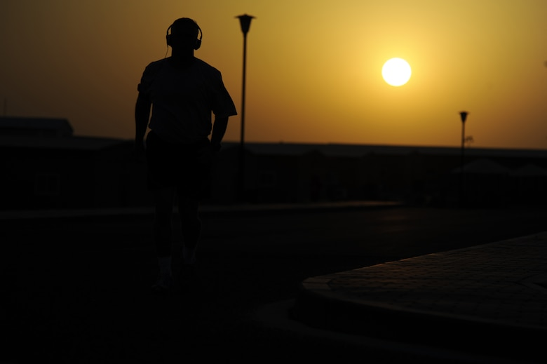 Master Sgt. Christopher Campbell, 386th Air Expeditionary Wing, photojournalist, completes one of his runs while the sun rises in the background here, Aug. 28, 2013. Campbell runs every day he can and he averages between 4.5 to 8 miles each run.  Campbell, a native of Phoenix, is deployed out of the 355th Fighter Wing, Davis-Monthan Air Force Base, Ariz. (U.S. Air Force photo by Master Sgt. Christopher A. Campbell)