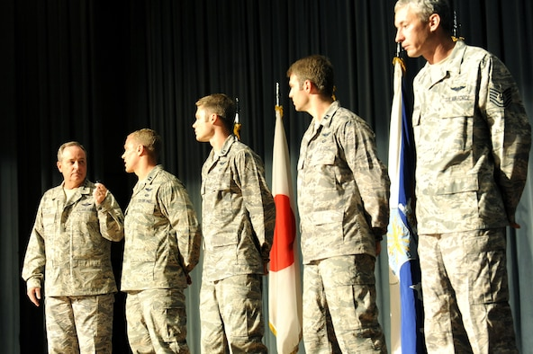 Capt. Michael Kingry explains a 320-mile rescue mission to Air Force Chief of Staff Gen. Mark A. Welsh III and the audience during an Airman's call Aug. 21, 2013, at Kadena Air Base, Japan. Five members of the 33rd Rescue Squadron were awarded the Distinguished Flying Cross with valor for their service during a mission in which they were under direct enemy fire and rescued critically wounded coalition soldiers during a deployment in 2012. Kingry is the 18th Operation Support Squadron chief of weapon tactics. (U.S. Air Force photo/Airman 1st Class Hailey R. Davis)