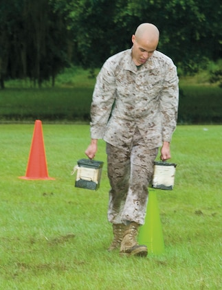 Lance Cpl. Gregory Perez joins fellow Marines in a recent combat fitness test at Marine Corps Logistics Base Albany. Perez competed in the ammunition-can carry, as part of an annual CFT requirement.