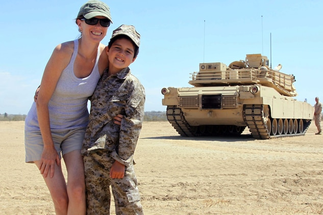 Casi Mayo and her son, Baden, hug infront of a tank Sept. 4. 7-year- old Bayden was diagnosed with Acute Lymphoblastic Leukemia December 10, 2010, his dream was to ride in a tank and Charity for Charity made that dream come true.