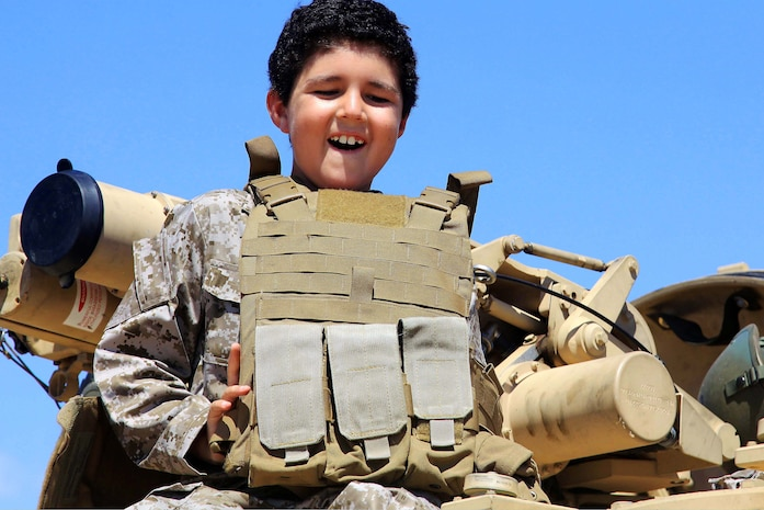 """Baden smiles after his tank ride on Camp Pendleton Sept. 4. 7-year-old Baden was diagnosed with Acute Lymphoblastic Leukemia December 10, 2010. """"I've always wanted to ride in a tank,"""" said Baden. """"It's just something no one else has done."""""""