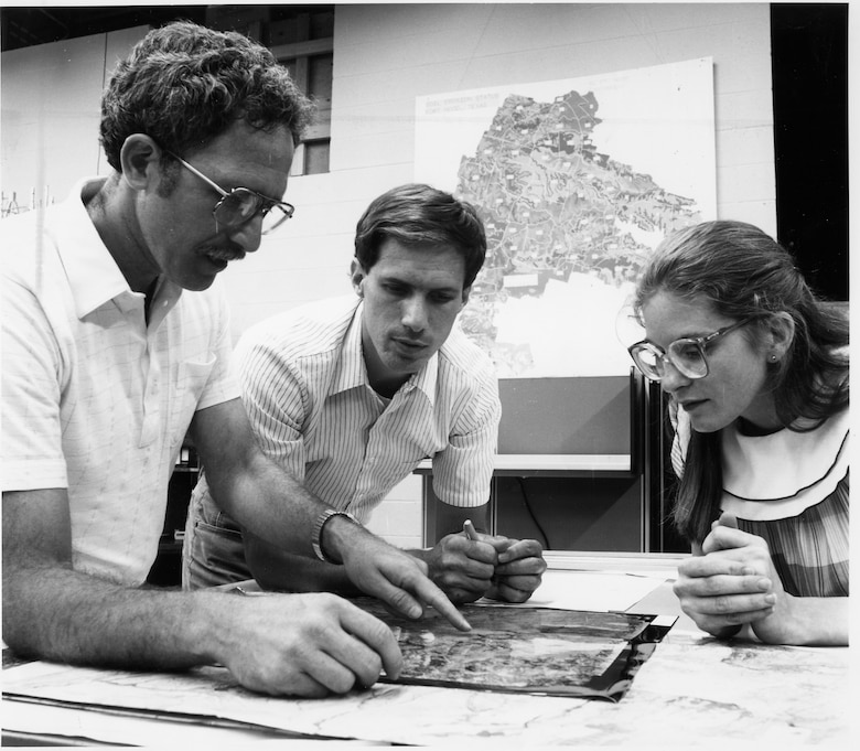 Construction Engineering Research Laboratory's Bill Goran (left), along with Jim Westervelt and Marilyn Ruiz, works on an early GRASS map in the late 1980s.