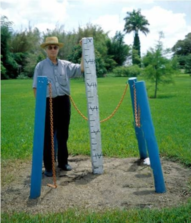 In 1924, this nine-foot concrete post was driven to bedrock at the Everglades Research and Education Center in Belle Glade. This photo shows about 69 inches of soil subsidence had already occurred in the Everglades Agricultural Area by 1998, an average of about 0.93 inches per year.