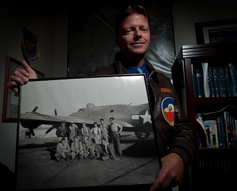 Paul Marcello, 28th Bomb Wing historian, holds a photograph taken in 1944 that includes his grandfather, Alfred Marcello, and his B-17 aircrew. The group received its combat crew training at Ellsworth nearly 70 years ago. Studying his grandfather's military career ultimately inspired Marecello to become Ellsworth's historian. (U.S. Air Force photo by Airman 1st Class Alystria Maurer/Released)