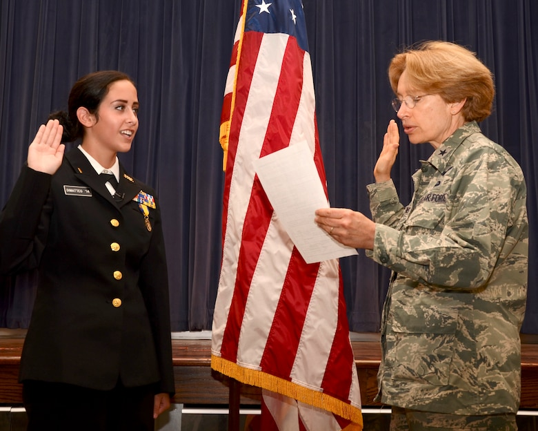 Dominique DiMatteo, a 17-year-old high school senior cadet at the Delaware Military Academy in Wilmington, Del., and a resident of Newport, Del. is sworn into the Delaware Air National Guard on Sept. 6, 2013, by Brig. Gen. Carol Timmons, assistant adjutant general for air, Delaware National Guard. Ms. DiMatteo's enlistment brings the authorized strength of the Delaware ANG to 100 percent, a recruiting milestone last reached during the Vietnam War era. After graduation from high school Ms. DiMatteo will attend Air Force Basic Training and technical school, and join the 142nd Aeromedical Evacuation Squadron, part of the 166th Airlift Wing. By coincidence the event occurred on the 67th anniversary of the founding of the Delaware ANG. (U.S. Air National Guard photo by Staff Sgt. Andrew Horgan)