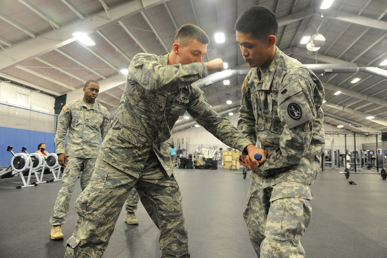 Staff Sgt. Colin Meizel, center, demonstrates weapons takeaway techniques to U.S. Army Sgt. Frankie Chan, right, and Sgt. Myles Covington, during a Fly Away Security Team course, at Joint Base Andrews, Md., Sept. 4. The course trains service members the tools and techniques to secure aircrafts globally. Both Soldiers are from the 212th Military Police Detachment at Fort Belvoir, Md.,  while Meizel is assigned to the 811th Security Forces Squadron executive aircraft security here. (U.S. Air Force Photo/Airman 1st Class Joshua R. M. Dewberry)