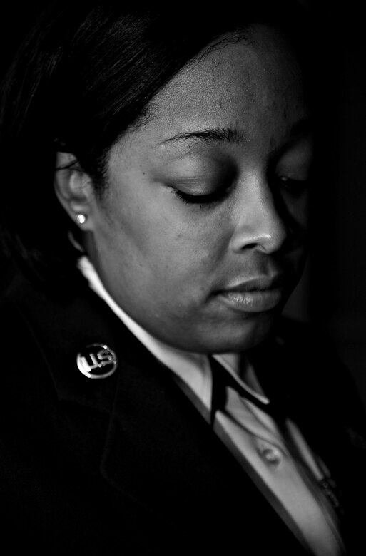 U.S. Air Force Master Sgt. Oniqua White-Muldrow recalls her experiences, at Langley Air Force Base, Va., Sept. 6, 2013, of the Sept. 11 attacks against the World Trade Center, New York. Muldrow specifically remembers people covered in ash and blood, crossing the Brooklyn Bridge – looking for the nearest hospital. (U.S. Air Force photo illustration by Staff Sgt. Jarad A. Denton/Released)