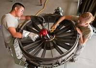 U.S. Air Force Airman Brandinn Kim and Elizabeth Ulring, 361st Training Squadron, Jet Propulsion course are heating a #1 Bearing Housing on the F-110 engine to ready it for the installation of a Rotating Air Seal on August 27, 2013 at Sheppard Air Force Base, Texas. The engine is from an F-15 aircraft. (U.S. Air Force photo by Frank Carter/Released)