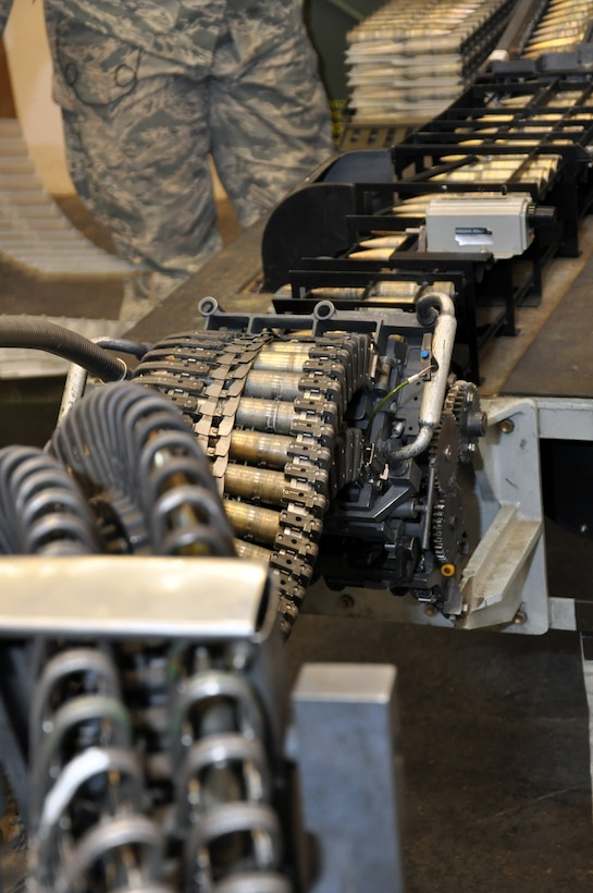 After being put on the 20mm ammunition loading table, rounds travel down the snaking belt into the Universal Ammunition Loading System Aug. 1, 2013, on Buckley Air Force Base, Colo. The UALS hold 1,525 rounds of 20mm ammunition used by F-16 Fighting Falcons. The 140th Wing handles the munitions needs of units across the Front Range. (U.S. Air Force photo by Staff Sgt. Nicholas Rau/Released)