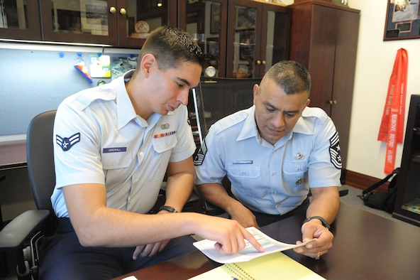 Chief Master Sgt. Gerardo Tapia, Air Education and Training Command command chief, mentors Airman 1st Class William Underhill, 902nd Contracting Squadron, Aug. 29 at Joint Base San Antonio-Randolph. (U.S. Air Force photo by Joel Martinez)
