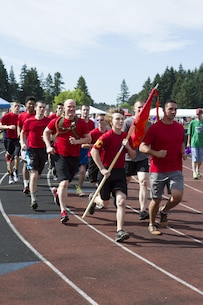 Marines and poolees from Recruiting Station Portland run during the Relay for Life Oregon City at Clackamas Community College, Oregon City, Ore., June 29. The Pooles with Recruiting Sub Station Gresham and RSS Oregon City ran a mile and a half followed by max set of pull-ups and crunches.