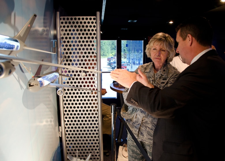 PEASE AIR NATIONAL GUARD, N.H. – New Hampshire Air National Guard Commander Brig. Gen. Carolyn J. Protzmann discusses the capabilities of the new KC-46A with James Eisenhart, Boeing Business Development director. Local civic leaders were invited to tour the Tanker Demonstration Trailer on the base. Wing personnel are invited to tour the trailer Sept. 7 from noon to 8 p.m. and Sept. 8 from 9 a.m. to 4 p.m. (Air National Guard photo by Tech. Sgt. Mark Wyatt/Released)