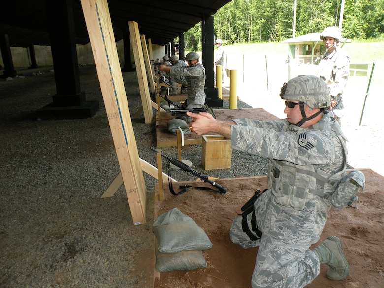 Staff. Sgt. Michael Stearns, 103rd Security Forces Squadron, takes aim during the Adjutant General's marksmanship competition held at the East Haven, Conn., Rifle Range Aug. 2–4, 2013. The Connecticut Air National Guard Security Forces teams came in first and third place out of 11 teams, beating the lead Army National Guard team by more than 300 points.  (U.S. Air National Guard Photo by Tech. Sgt. Jessica Roy)